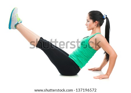 Beautiful sporty woman doing exercise on the floor. Isolated on white background - stock photo