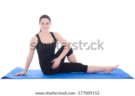 beautiful sporty woman sitting on the floor isolated on white background