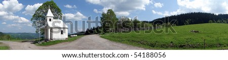 Beautiful spring and nature panorama with the chapel - stock photo