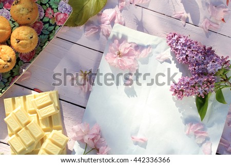 Beautiful, Spring floral background with Japanese cherry blooming flowers and white chocolate