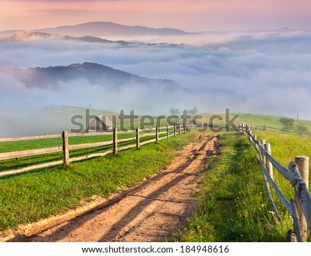 Beautiful spring landscape in a mountain village - stock photo