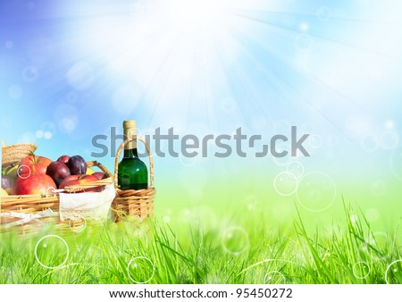 Beautiful spring scenery with picnic in meadow - stock photo