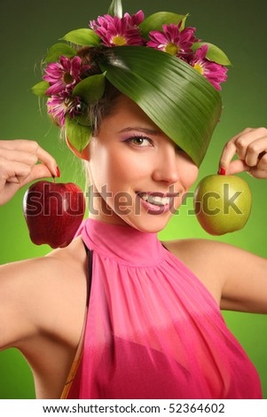 beautiful spring-woman with two apples - stock photo