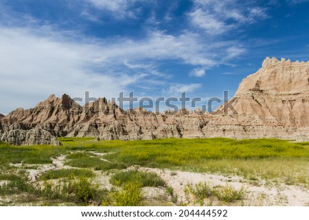 beautiful springtime landscape of the Badlands in south dakota with spring green grass - stock photo
