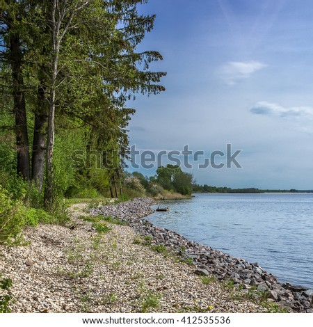 Beautiful square background to the shore of lake Udomlya may Sunny day.