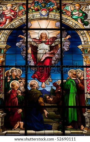 Beautiful stained glass window created by F. Zettler (1878-1911) at the German Church in Gamla Stan in Stockholm. Motif depicting the resurrection of Jesus, celebrated on Easter Sunday. - stock photo