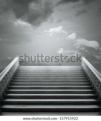 Beautiful staircase with a cloudy sky in black and white - stock photo