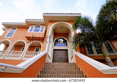 Beautiful stairway to a luxurious, large mansion in Florida. - stock photo