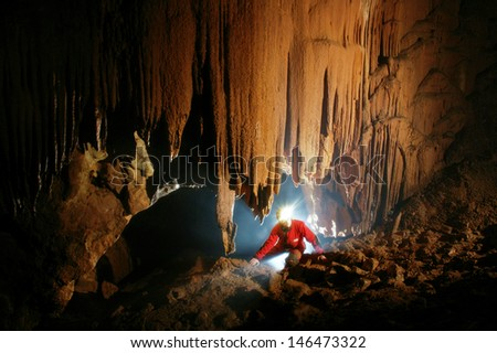 Beautiful stalactites in a cave  - stock photo
