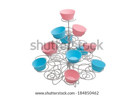 Beautiful stand for cupcakes on white background