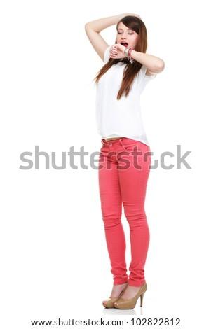 Beautiful standing yawning stretching woman in red Studio shot. - stock photo