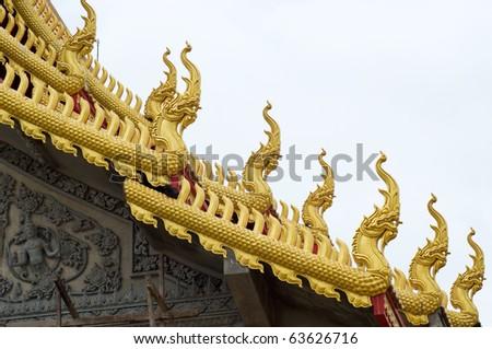 beautiful statue king of naga on thai temple roof at Ratchaburi Thailand - stock photo
