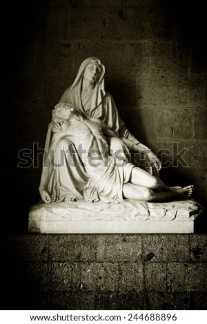 beautiful statue of Holy Mary holding the Corpus Christi on her lap - stock photo
