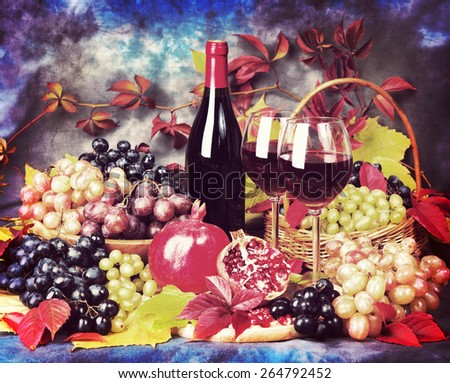 Beautiful still life with wine glasses, grapes, pomegranate. Vintage retro hipster style. - stock photo