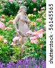 Beautiful stone statue in rose garden - stock photo