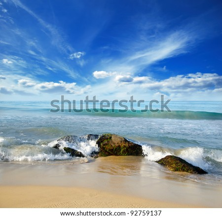 beautiful stones in the waves on ocean coast - stock photo
