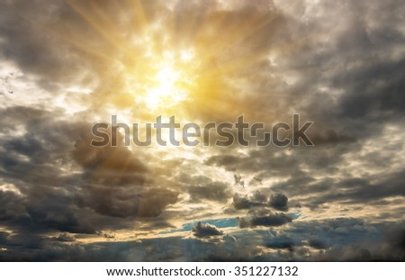 Beautiful storm clouds in the sky and the sun filtering through them