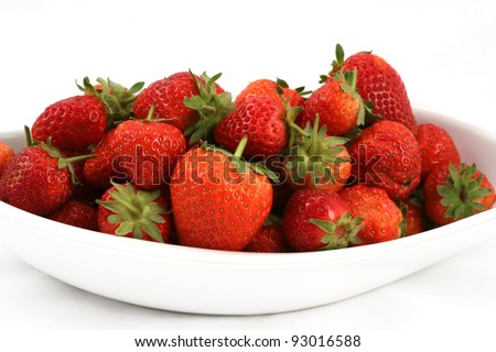 Beautiful strawberries in white dish isolated on white - stock photo