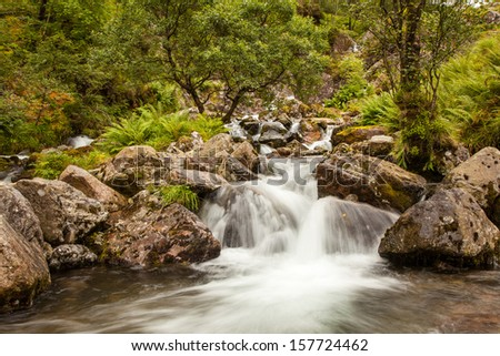 Beautiful stream and waterfall in the Highlands of Scotland, Glen Coe Valley - stock photo