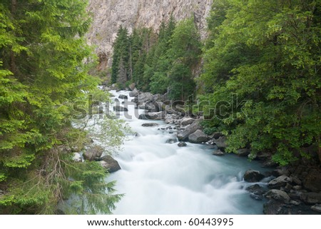 beautiful stream between rocks in Pre Saint Didier, Aosta. Italy - stock photo