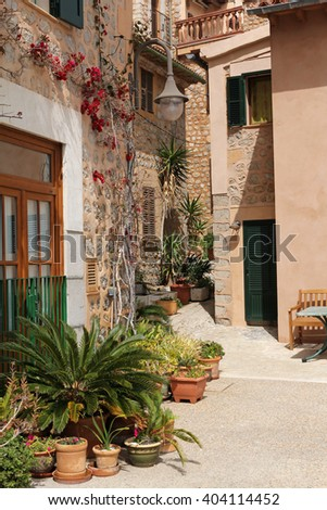 beautiful street decorated with flowers in Port de Soller, Majorca, Spain - stock photo