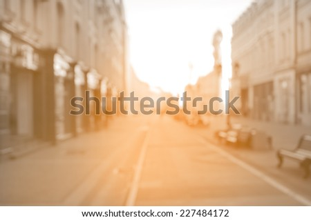 beautiful street in the historical city center at sunrise time. Blurred vintage image. - stock photo