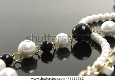 Beautiful string of beads, necklace isolated on gray background - stock photo