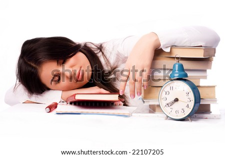 beautiful student falls asleep on the table while preparing for the test - stock photo