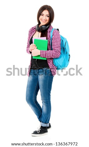 Beautiful student girl with backpack, black headphones and books, isolated on white background