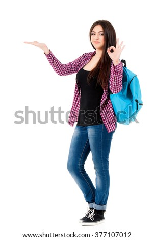 Beautiful student girl with backpack, isolated on white background - stock photo