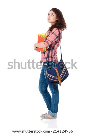 Beautiful student girl with bag and books, isolated on white background - stock photo
