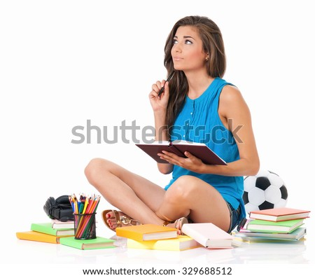 Beautiful student girl with books sitting on floor, isolated on white background