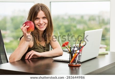 Beautiful student girl working at the computer - stock photo