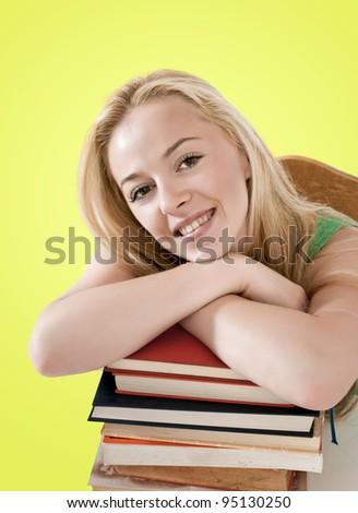 beautiful student leaning on books - stock photo