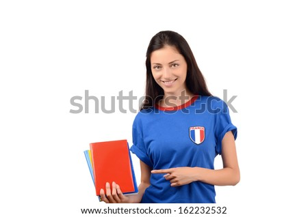 Beautiful student pointing to the blank book cover. Attractive girl with blue t-shirt holding books. Isolated on white. - stock photo