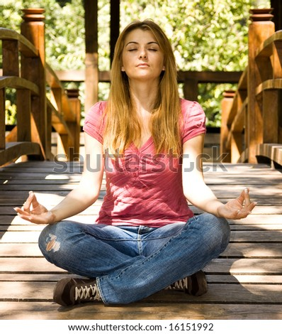 Beautiful student practice yoga outdoor. - stock photo