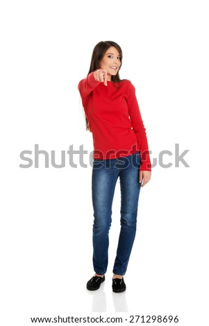 Beautiful student woman pointing on you. - stock photo