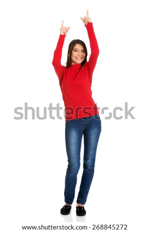 Beautiful student woman pointing up. - stock photo