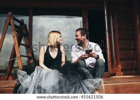 Beautiful stylish couple rest in the house on the coast