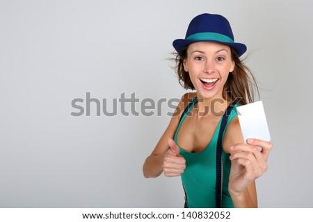 Beautiful stylish girl holding pass ticket - stock photo
