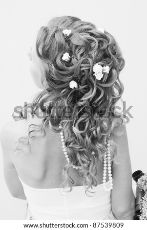 Beautiful stylish hairstyle with woven flowers