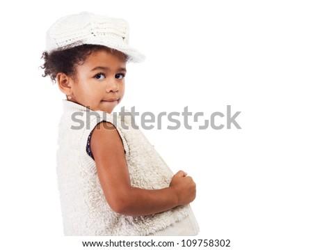 Beautiful stylish little girl in white clothing - stock photo