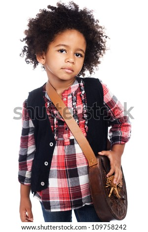 Beautiful stylish little girl with leather bag - stock photo
