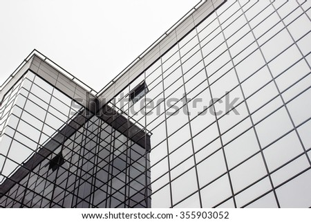 beautiful stylish urban geometric gray and black building of glass, business and future concept - stock photo