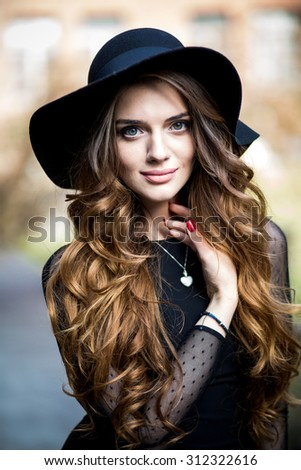 beautiful stylish young woman (girl) in dress and hat - stock photo
