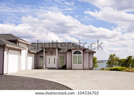 beautiful suburban luxury house at sunny day - stock photo