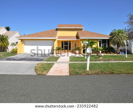 Beautiful suburban ranch home residential neighborhood sunny blue sky USA - stock photo