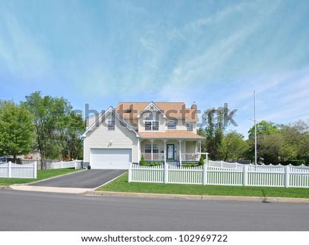 Beautiful Suburban Victorian Style Home White Picket Fence Residential District Neighborhood Sunny Blue Sky Day - stock photo