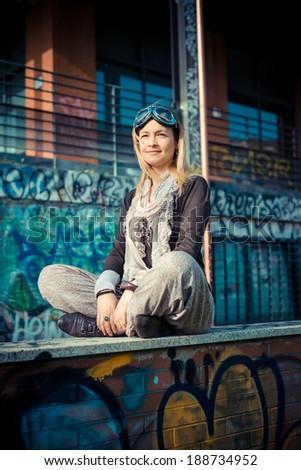 beautiful success aviator woman in the city - stock photo