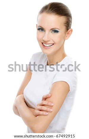 Beautiful successful smiling young woman with crossed hands looks confidently in future, on white background.